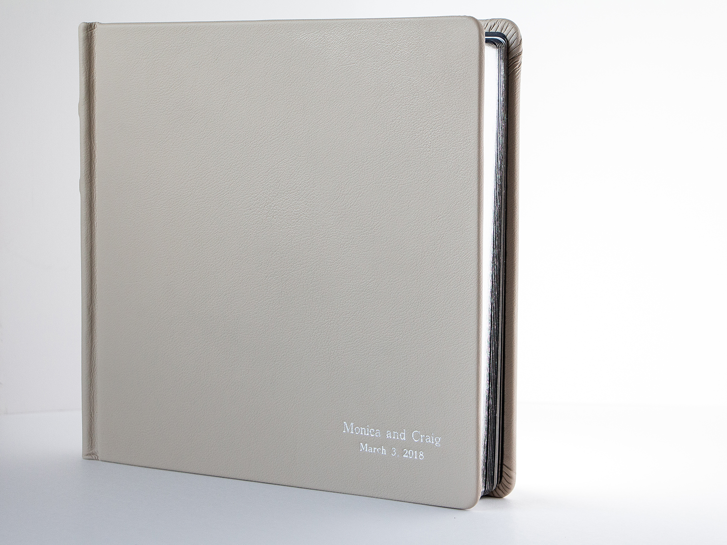 800 Matted Album Traditional Cover Featuring Euro Sand Leather, Rounded Cover Corners, Round Cornered Gilded Pages, And Block Type Font Imprinted In Silver Foil